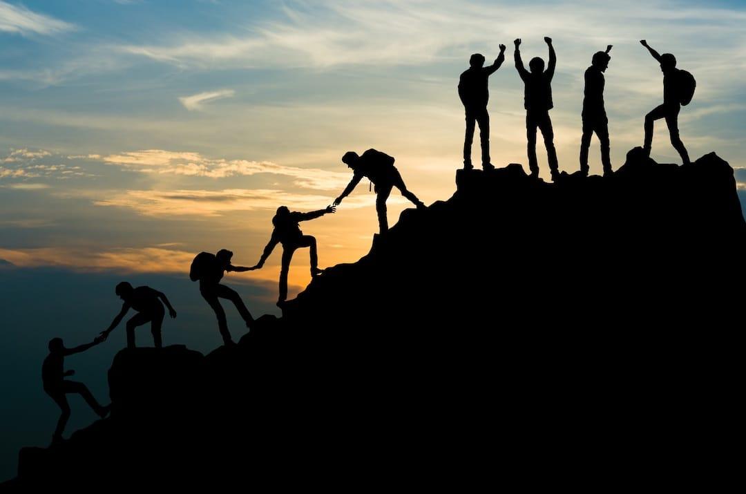 Climbing mountain reaching success